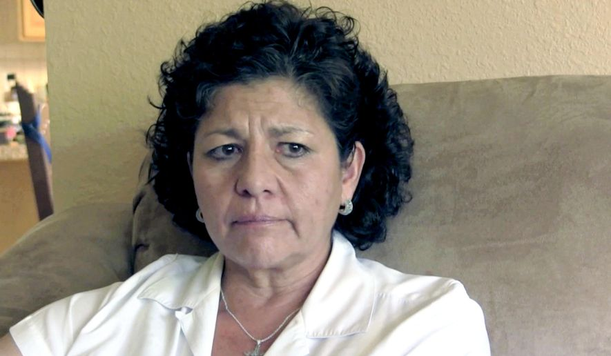 FILE - In this July 14, 2015 file photo from video, Tina Cordova talks of her late father, Anastacio Cordova, in her Albuquerque home. Cordova believes her father, who died in 2013 after suffering from multiple bouts of cancer, was affected by the atomic bomb Trinity Test in New Mexico since he lived in nearby Tularosa, N.M. as a child. Residents of a New Mexico Hispanic village near the site of the world's first atomic bomb test want to share their stories with Congress this summer. The Tularosa Basin Downwinders Consortium is raising money so its members can travel to Washington, D.C., and testify about the effects of the Trinity Test on generations of Tularosa residents.  (AP Photo/Russell Contreras,File)