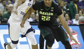 Baylor's King McClure (22) drives under pressure from West Virginia's Jevon Carter (2) during the first half of an NCAA college basketball game in the Big 12 men's tournament Thursday, March 8, 2018, in Kansas City, Mo. (AP Photo/Charlie Riedel)