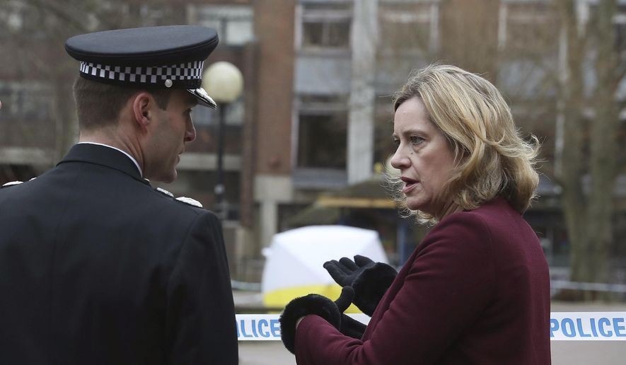 Britain's Home Secretary Amber Rudd talks with Wiltshire Police Assistant Chief Constable Kier Pritchard during a visit to the scene at the Maltings shopping centre in Salisbury where former Russian double agent Sergei Skripal and his daughter were found critically ill after exposure to a nerve agent, Friday March 9, 2018. Three people remain hospitalized Friday after the poisoning of former spy Sergei Skripal, his daughter Yulia and British police officer Nick Bailey who tried to help them.(Andrew Matthews/PA via AP)