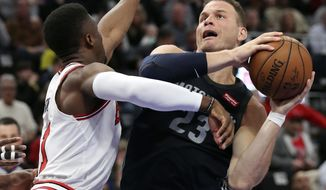Detroit Pistons forward Blake Griffin (23) attempts to shoot as Chicago Bulls forward David Nwaba defends during the first half of an NBA basketball game, Friday, March 9, 2018, in Detroit. (AP Photo/Carlos Osorio)