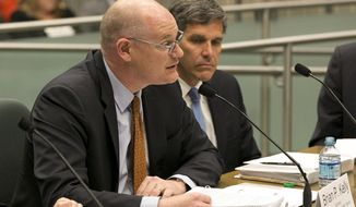 FILE -- In this Monday March 28, 2016 file photo, Brian Kelly, former Secretary of the California State Transportation Agency, left, testifies before the Assembly Transportation Committee, in Sacramento, Calif. Kelly was hired in January 2018, as the new chief executive officer of the High-Speed Rail Authority, replacing Jeff Morales, right, who resigned last year. The rail authority on Friday , March 9, 2018, will release its latest business plan, the first since Kelly took over the bullet train project which has been beset by delays and cost increases. (AP Photo/Rich Pedroncelli, file)