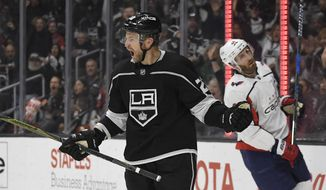 Los Angeles Kings center Trevor Lewis, left, celebrates his goal as Washington Capitals defenseman Brooks Orpik skates behind him during the second period of an NHL hockey game Thursday, March 8, 2018, in Los Angeles. (AP Photo/Mark J. Terrill)