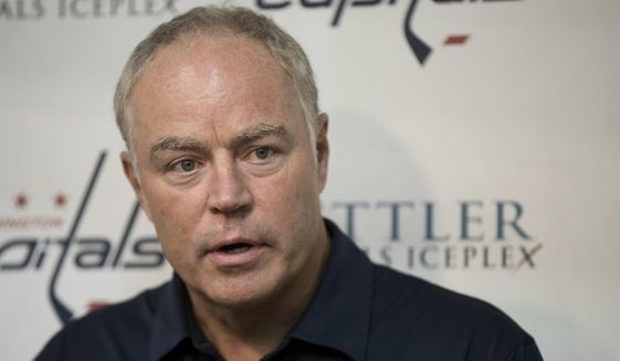 FILE - In this Sept. 23, 2016, file photo, Washington Capitals' general manager Brian MacLellan speaks to reporters during the first day of NHL hockey training camp, in Arlington, Va. The  Capitals have re-signed general manager Brian MacLellan to a contract extension. MacLellan is in the fourth year of his original four-year deal when he was promoted from assistant GM to replace McPhee. The team confirmed the extension Friday, March 9, 2018, in the midst of its California road trip. (AP Photo/Manuel Balce Ceneta) ** FILE **