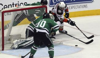 Anaheim Ducks right wing J.T. Brown (71) tries to come around the goal for a shot against Dallas Stars goaltender Kari Lehtonen (32) and left wing Remi Elie (40) in the second period of an NHL hockey game Friday, March 9, 2018, in Dallas. (AP Photo/ Richard W. Rodriguez)