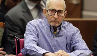 FILE - In this Dec. 21, 2016 file photo, millionaire real estate heir Robert Durst sits in a courtroom in Los Angeles. Prosecutors in the Los Angeles murder case against eccentric New York real estate heir Durst say his victim's words should be used against him in court. Prosecutors filed nearly 400 pages of documents Friday, March 9, 2018, to argue that hearsay testimony be allowed to help prove Durst killed Susan Berman in 2000 to silence what she knew about his first wife's mysterious 1982 disappearance.  (AP Photo/Jae C. Hong, Pool, File)
