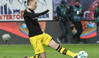 FILE - In this March 3, 2018 photo Dortmund's Marco Reus scores a goal during the German first division Bundesliga soccer match between RB Leipzig and Borussia Dortmund in Leipzig, Germany. (AP Photo/Jens Meyer, file)