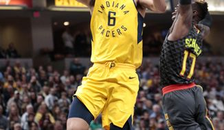 Indiana Pacers guard Cory Joseph (6) goes to the basket in front of Atlanta Hawks guard Dennis Schroeder during the first half of an NBA basketball game in Indianapolis, Friday, March 9, 2018. (AP Photo/AJ Mast)