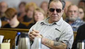 Freddie Joe Lawrence listens to testimony Friday, March 9, 2018,  in Helena, Mont., during a hearing to review new DNA evidence related to the murder of Donna Meagher, which Lawrence was convicted of in 1995. (Thom Bridge/Independent Record via AP)