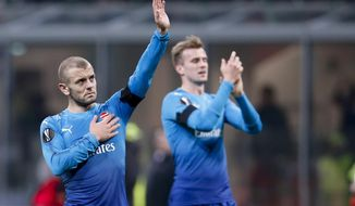 Arsenal's Jack Wilshere waves to fans at the end of the Europa League, round of 16 first-leg soccer match between AC Milan and Arsenal, at the Milan San Siro stadium, Italy, Thursday, March 8, 2018. Arsenal won 2-0. (AP Photo/Antonio Calanni)