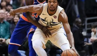 Milwaukee Bucks' Sterling Brown tries to drive past New York Knicks' Damyean Dotson during the first half of an NBA basketball game Friday, March 9, 2018, in Milwaukee. (AP Photo/Morry Gash)