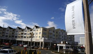 In this Monday, March 5, 2018 photo, the Pier Village development is seen in Long Branch, N.J. The federal government has been advising a beach town on the Jersey Shore on plans to build a pier and start a ferry service that would speed New Yorkers to the doorstep of a resort co-owned by Jared Kushner. (AP Photo/Seth Wenig)
