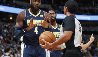 Denver Nuggets forward Paul Millsap, left, argues for a foul with referee Bill Kennedy during the first half of the team's NBA basketball game against the Los Angeles Lakers on Friday, March 9, 2018, in Denver. (AP Photo/David Zalubowski)