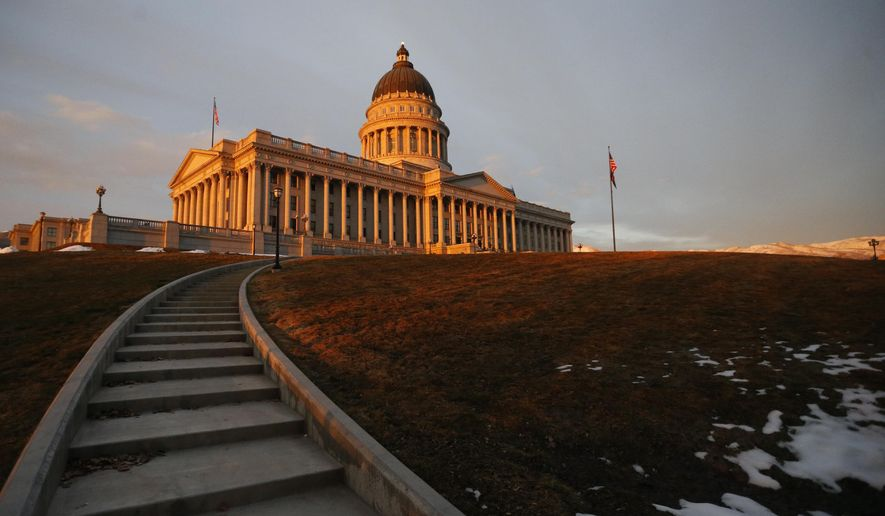 The sunsets on the Utah state Capitol, Thursday, March 8, 2018, in Salt Lake City. Utah lawmakers wound down their annual session Thursday after opening a record number of bills but failing to pass proposals on hot-button issues, including a repeal of the death penalty and a gun-control measure. (AP Photo/Rick Bowmer)