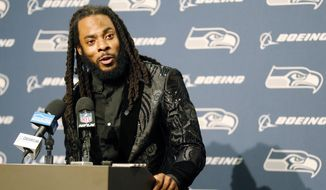 FILE - In this Oct. 29, 2017, file photo, Seattle Seahawks cornerback Richard Sherman talks to reporters during a post-game press conference following an NFL football game against the Houston Texans, in Seattle. The Seahawks are cutting ties with star cornerback Richard Sherman after seven seasons. The team has informed him that he will be released, and Sherman confirmed the decision in a text message to The Associated Press on Friday, March 9, 2018. (AP Photo/Stephen Brashear, File)