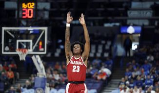 Alabama's John Petty celebrates during the second half in an NCAA college basketball quarterfinal game against Auburn at the Southeastern Conference tournament Friday, March 9, 2018, in St. Louis. Alabama won 81-63. (AP Photo/Jeff Roberson)