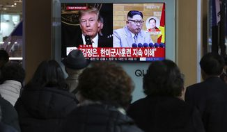 "People watch a TV screen showing North Korean leader Kim Jong Un and U.S. President Donald Trump, left, at the Seoul Railway Station in Seoul, South Korea, Friday, March 9, 2018. After months of trading insults and threats of nuclear annihilation, Trump agreed to meet with North Korean leader Kim Jung Un by the end of May to negotiate an end to Pyongyang's nuclear weapons program, South Korean and U.S. officials said Thursday. No sitting American president has ever met with a North Korea leader. The signs read: "" Kim Jong Un understands that the routine joint military exercises between the South Korean and the United States must continue."" (AP Photo/Ahn Young-joon)"