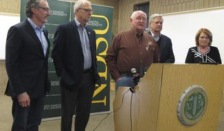 U.S. Agriculture Secretary Sonny Perdue talks at a news conference in Fargo, N.D., on Friday, March 9, 2018. Perdue spoke about how President Donald Trump's tariffs on steel and aluminum might help farmers get a better deal in the long run if the North American Free Trade Agreement is improved. From left are North Dakota Gov. Doug Burgum, U.S Rep. Kevin Cramer, Perdue, and U.S. Sens. John Hoeven and Heidi Heitkamp. It was the first trip to North Dakota for Perdue, who has now visited 34 states. (AP Photo/Dave Kolpack)