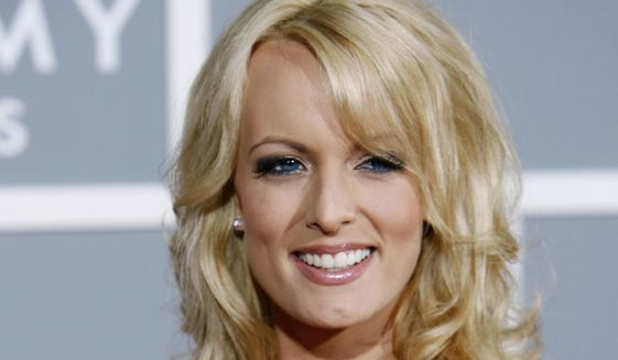 In this Feb. 11, 2007, file photo, Stormy Daniels arrives for the 49th Annual Grammy Awards in Los Angeles. (AP Photo/Matt Sayles) ** FILE **