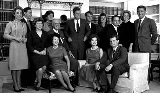 FILE - In this Nov. 9, 1960 file photo, President-elect John F. Kennedy, center, is surrounded by members of his family in the living room of the home of Joseph P. Kennedy, in Hyannisport, Mass. Standing, from left, Ethel Kennedy; Steve Smith and wife, Jean Kennedy; Senator Kennedy; brother Robert, campaign manager; sister, Patricia Lawford; Sargent Shriver; brother Ted's wife, Joan; and British actor Peter Lawford. In foreground, seated from are: Eunice Shriver, sister; mother Rose Kennedy; father, Joseph; Jacqueline Kennedy, wife of John; and Ted Kennedy, brother of the president-elect. CNN debuts a six-part series on the Kennedy family, part of its focus on historical programming for its original series (AP Photo, file)