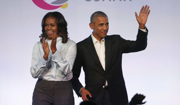 Former President Barack Obama and former first lady Michelle Obama have signed a multiyear deal with Netflix. (Associated Press/File)