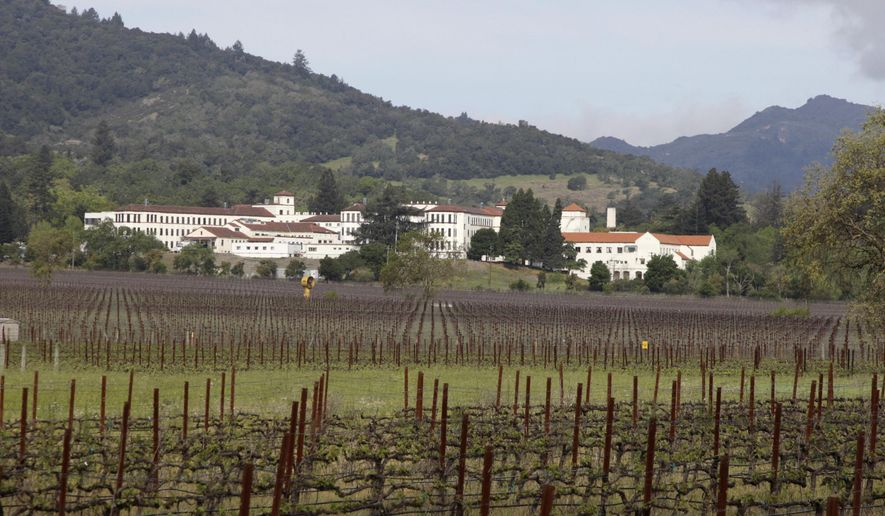 File - In this April 17, 2011 file photo, vineyards are shown in front of the Veterans Home of California in Yountville, Calif. Napa County Fire captain Chase Beckman says a gunman has taken hostages Friday, March 9, 2018, at the veterans home. Police closed access to the large veterans home in Yountville after a man with a gun was reported on the grounds. (AP Photo/Eric Risberg, File)