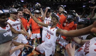 Virginia players celebrate after defeating North Carolina in the championship game of the NCAA Atlantic Coast Conference men's college basketball tournament, Saturday, March 10, 2018, in New York. (AP Photo/Julie Jacobson) ** FILE **