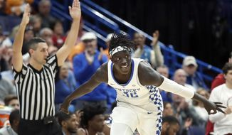 Kentucky's Wenyen Gabriel celebrates after making a 3-point basket during the first half of an NCAA college basketball game against Alabama in the semifinals of the Southeastern Conference tournament Saturday, March 10, 2018, in St. Louis. (AP Photo/Jeff Roberson)