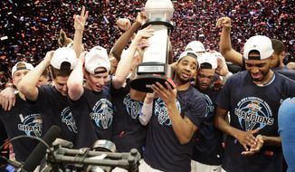 Villanova players hold the tournament trophy after an NCAA college basketball game against Providence in the Big East men's tournament final Saturday, March 10, 2018, in New York. Villanova won 76-66 in overtime. (AP Photo/Frank Franklin II)