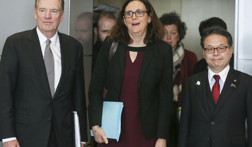 European Commissioner for Trade Cecilia Malmstroem, center, Japanese Minister for Economy, Trade and Industry Hiroshige Seko, right, and U.S. Trade Representative Robert Lighthizer, pose for photographers prior to a meeting at EU headquarters in Brussels on Saturday, March 10, 2018. The EU is still seeking clarity from Washington about whether the 28-nation bloc will be exempt from U.S. President Donald Trump's steel and aluminum tariffs. (Stephanie Lecocq, Pool Photo via AP)