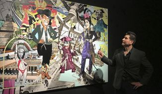 "In this Feb. 16, 2018, photo border artist Claudio Dicochea explains one of the paintings in his ""Acid Baroque"" exhibit on display at the Scottsdale Museum of Contemporary Art in Scottsdale, Ariz., through May 20. These and other works by the 45-year-old Dicochea give a contemporary psychedelic spin to the colonial ""casta"" or caste paintings first created in 18th century Mexico, taking us to the crossroads of colonialism and modern day popular culture as he examines the concept of ""mestizaje,"" or mixed identity. (AP Photo/Anita Snow)"