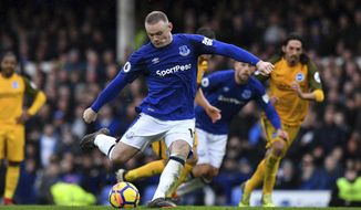 Everton's Wayne Rooney takes and misses a penalty against Brighton & Hove Albion during their English Premier League soccer match at Goodison Park in Liverpool, England, Saturday March 10, 2018. (Anthony Devlin/PA via AP)