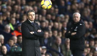 Leicester City manager Claude Puel, left, and West Brom manager Alan Pardew watch the game during their English Premier League soccer match at The Hawthorns in West Bromwich, England, Saturday March 10, 2018. (Nick Potts/PA via AP)