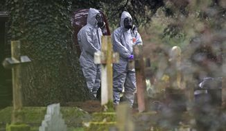 Forensic officers work at the cemetery in Salisbury, England, Saturday March 10, 2018, as investigations continue at the cemetery where former Russian double agent Sergei Skripal's wife Liudmila and son Alexander are laid to rest.  Emergency service personnel and troops trained in chemical warfare were deployed on the streets of Salisbury as investigations continue into the nerve-agent poisoning of a former Russian spy and his daughter. (PA via AP)