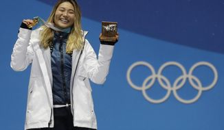 FILE - In this Feb. 13, 2018, file photo, women's halfpipe gold medalist ChloeKim, of the United States, poses during the medals ceremony at the 2018 Winter Olympics in Pyeongchang, South Korea. Three weeks after winning at the Olympics and transforming herself from a mere snowboarder into a full-fledged celebrity, 17-year-old Chloe Kim is the first to admit she never realized what a big deal her victory would be. (AP Photo/Morry Gash, File)