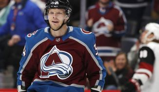 Colorado Avalanche center Carl Soderberg celebrates after scoring a goal against the Arizona Coyotes in the first period of an NHL hockey game Saturday, March 10, 2018, in Denver. (AP Photo/David Zalubowski)