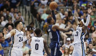 Dallas Mavericks forward Harrison Barnes (40) attempts a shot as Memphis Grizzlies guard Ben McLemore (23) and forwards JaMychal Green (0) and Dillon Brooks (24) defend during the first half of an NBA basketball game, Saturday, March 10, 2018, in Dallas. (AP Photo/Brandon Wade)