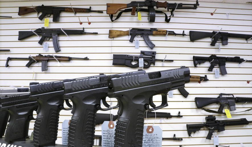 The increase of 100,000, to 2.3 million run through the National Instant Criminal Background Check System, breaks a five-month streak of year-over-year declines. (Associated Press/File)