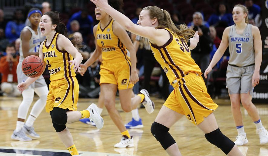 Central Michigan guard Presley Hudson (3), Tinara Moore (2) and Kyra Bussell (50) celebrate after defeating Buffalo 96-91 in an NCAA college basketball game in the championship of the Mid-American Conference tournament Saturday, March 10, 2018, in Cleveland. (AP Photo/Ron Schwane)