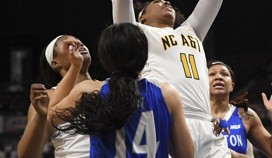 North Carolina A&T forward Jade Scaife goes up for a shot against Hampton during an NCAA college basketball game in the finals of the Mid-Eastern Athletic Conference tournament Saturday, March 10, 2018, in Norfolk, Va. (AP Photo/Russell Tracy)