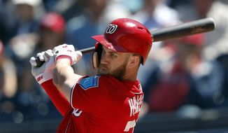 Washington Nationals right fielder Bryce Harper (34) drives in a run with a base hit in the fifth inning of a spring training baseball game against the New York Mets, Thursday, March 8, 2018, in West Palm Beach, Fla. (AP Photo/John Bazemore)