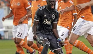 Vancouver Whitecaps's Kei Kamara (23) reacts after scoring a goal on a penalty kick against the Houston Dynamo during the first half of an MLS soccer game Saturday, March 10, 2018, in Houston. (AP Photo/David J. Phillip)