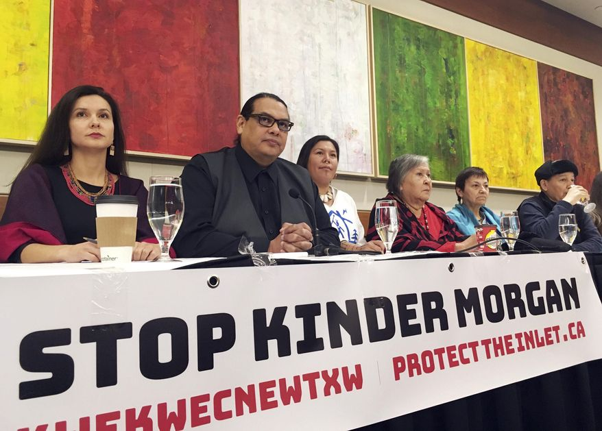 Indigenous leaders speak at a news conference in Vancouver, British Columbia, Canada, on Friday, March 9, 2018, prior to a planned protest over a pipeline expansion project that would pump oil from Canada's tar sands to the Pacific Coast. Thousands are expected to march Saturday in the Metro Vancouver area. (AP Photo/Phuong Le)