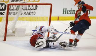 Florida Panthers center Vincent Trocheck, right, scores against New York Rangers goaltender Henrik Lundqvist (30) during the shootout in an NHL hockey game Saturday, March 10, 2018 in Sunrise, Fla. The Panthers won 4-3. (AP Photo/Wilfredo Lee)