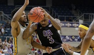 Stephen F. Austin forward Leon Gilmore III (3) drives between Southeastern Louisiana forward Moses Greenwood (13) and guard Marlain Veal (0) during the first half of an NCAA college basketball game in the Southland Conference's Men's Basketball Tournament Championship Saturday, March 10, 2018, in Houston. (AP Photo/Michael Wyke)