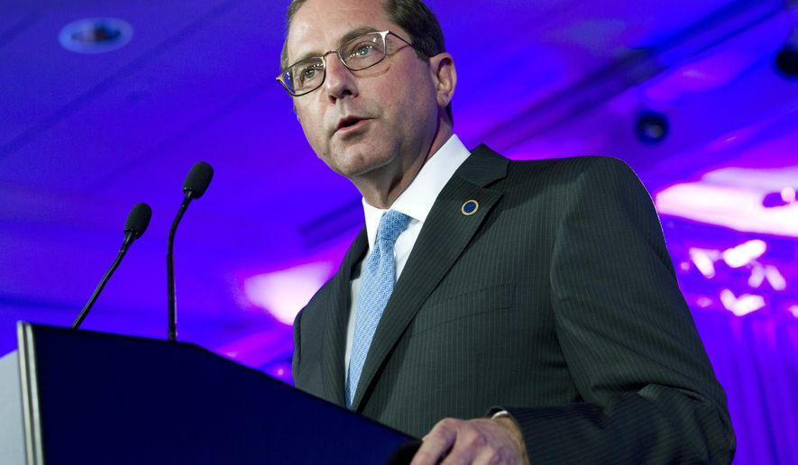 FILE - In this Feb. 24, 2018, file photo, Department of Health and Human Services Secretary Alex Azar speaks at the National Governor Association 2018 winter meeting in Washington. The Trump administration is taking a pragmatic new track on health care with officials promising consumer-friendly changes and savings in areas from computerized medical records to prescription drugs. Azar has been rolling out the agenda, saying it has the full backing of President Donald Trump.(AP Photo/Jose Luis Magana, File)