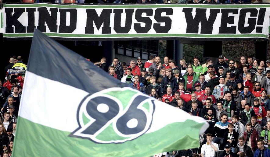 """Banner reads 'Kind must go"""" during a match of German first soccer Bundeslga division between Hannover 96 and Augsburg in Hannover, Germany, Saturday, March 10, 2018. (Sven Pfortner/dpa via AP)"""