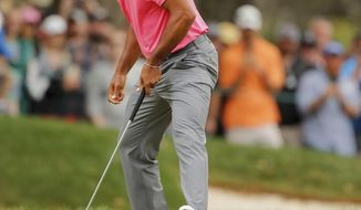 Tiger Woods watches his birdie putt on the third hole during the third round of the Valspar Championship golf tournament Saturday, March 10, 2018, in Palm Harbor, Fla. (AP Photo/Mike Carlson)