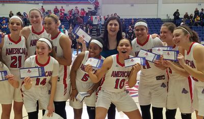 "The American University women's basketball team celebrates holding their ""tourney tickets"" after defeating Navy 58-49 in the Patriot League Championship Game on Sunday, March 11 at Bender Arena in Washington. American advances to the NCAA Women's Basketball Tournament. (Adam Zielonka / Washington Times)"