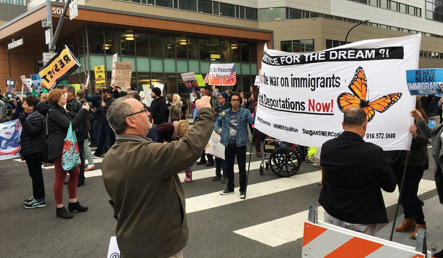 Demonstrators block traffic in front of the hotel where Attorney General Jeff Sessions was speaking to the California Peace Officers Association meeting, Wednesday. Activists are increasingly protesting specific arrests and deportations, most recently Perla Morales-Luna.