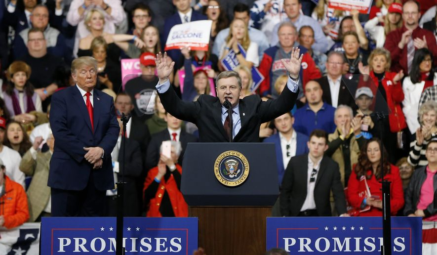 Republican Rick Saccone greeted the crowd during a campaign rally with President Donald Trump on Saturday in Moon Township, Pennsylvania. His Democratic opponent is keeping his distance from the president. (Associated Press)